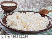 Купить «cottage cheese on dish with spoon and cream in bowl», фото № 26882296, снято 7 июня 2020 г. (c) Oksana Zh / Фотобанк Лори