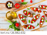 Купить «bruschetta with tomatoes, mini mozzarella and basil leaves», фото № 26882632, снято 29 августа 2016 г. (c) Oksana Zh / Фотобанк Лори