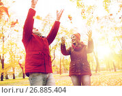 Купить «happy young couple throwing autumn leaves in park», фото № 26885404, снято 9 октября 2016 г. (c) Syda Productions / Фотобанк Лори