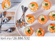 Купить «Shot-Glass Shrimp with tartar sauce - easy cocktail recipe for festive party, on white platter with spoons on old white wooden table, view from above, close-up», фото № 26886532, снято 13 декабря 2016 г. (c) Oksana Zh / Фотобанк Лори
