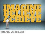 Купить «Business woman standing in front of a motivational text», фото № 26886788, снято 17 февраля 2019 г. (c) Wavebreak Media / Фотобанк Лори