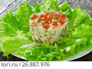 Купить «olivier- potato salad with chopped pickles, sausages and vegetables», фото № 26887976, снято 22 ноября 2018 г. (c) Oksana Zh / Фотобанк Лори