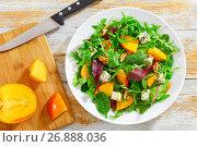 Купить «salad with persimmon slices, mix of lettuce leaves, blue cheese», фото № 26888036, снято 14 декабря 2017 г. (c) Oksana Zhupanova / Фотобанк Лори