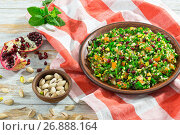Купить «salad with pomegranate, pistachio nuts, parsley, peppermint, spring onion, tomato», фото № 26888164, снято 18 января 2019 г. (c) Oksana Zh / Фотобанк Лори