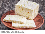 Купить «Feta Cheese cut in slices on plate», фото № 26888932, снято 21 июня 2019 г. (c) Oksana Zh / Фотобанк Лори