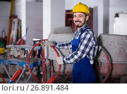 Купить «working man practicing his skills with mixing unit at workshop», фото № 26891484, снято 17 января 2017 г. (c) Яков Филимонов / Фотобанк Лори