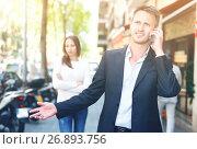 Купить «Young man and woman phubbing», фото № 26893756, снято 11 апреля 2017 г. (c) Яков Филимонов / Фотобанк Лори