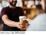 Купить «man or bartender serving customer at coffee shop», фото № 26909828, снято 8 декабря 2016 г. (c) Syda Productions / Фотобанк Лори