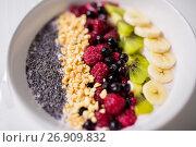 Купить «bowl of yogurt with fruits and seeds», фото № 26909832, снято 8 декабря 2016 г. (c) Syda Productions / Фотобанк Лори