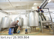 Купить «men working at craft beer brewery kettles», фото № 26909864, снято 24 марта 2017 г. (c) Syda Productions / Фотобанк Лори