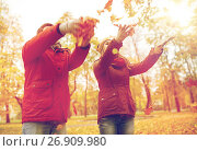 Купить «happy young couple throwing autumn leaves in park», фото № 26909980, снято 9 октября 2016 г. (c) Syda Productions / Фотобанк Лори