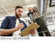 Купить «men with clipboard at brewery or beer plant kettle», фото № 26910056, снято 24 марта 2017 г. (c) Syda Productions / Фотобанк Лори