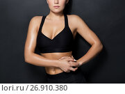Купить «close up of woman in black sportswear posing», фото № 26910380, снято 26 апреля 2017 г. (c) Syda Productions / Фотобанк Лори