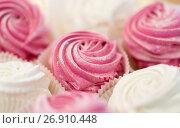 Купить «close up of zephyr or marshmallow dessert on plate», фото № 26910448, снято 8 мая 2017 г. (c) Syda Productions / Фотобанк Лори