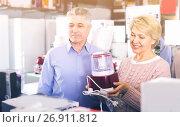 Купить «Man and woman 47-57 years old are buying in shop of household ap», фото № 26911812, снято 22 августа 2019 г. (c) Яков Филимонов / Фотобанк Лори