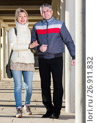 Купить «Friendly husband and wife are walking together», фото № 26911832, снято 16 августа 2018 г. (c) Яков Филимонов / Фотобанк Лори