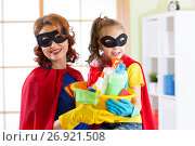 Купить «Mother and her child in Superhero costumes. Mom and kid ready to house cleaning. Housework and housekeeping.», фото № 26921508, снято 26 февраля 2017 г. (c) Оксана Кузьмина / Фотобанк Лори