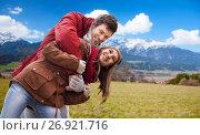 happy young couple having fun over alps mountains. Стоковое фото, фотограф Syda Productions / Фотобанк Лори