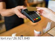 Купить «hands with payment terminal and credit card», фото № 26921840, снято 8 декабря 2016 г. (c) Syda Productions / Фотобанк Лори