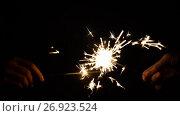 Купить «hands playing with burning sparklers in darkness», видеоролик № 26923524, снято 9 сентября 2017 г. (c) Syda Productions / Фотобанк Лори