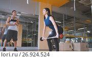 Купить «Girl with coach in the gym lifting up the barbell», фото № 26924524, снято 26 февраля 2020 г. (c) Константин Шишкин / Фотобанк Лори