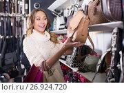 Купить «Excited young female shopping new handbag», фото № 26924720, снято 19 января 2019 г. (c) Яков Филимонов / Фотобанк Лори
