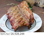Купить «Копченые свиные ребрышки», фото № 26928244, снято 2 сентября 2017 г. (c) Дудакова / Фотобанк Лори