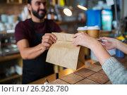 Купить «man or bartender serving customer at coffee shop», фото № 26928780, снято 8 декабря 2016 г. (c) Syda Productions / Фотобанк Лори