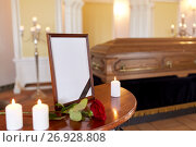 Купить «photo frame and coffin at funeral in church», фото № 26928808, снято 20 марта 2017 г. (c) Syda Productions / Фотобанк Лори