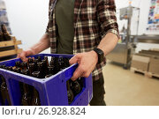 Купить «man with bottles in box at craft beer brewery», фото № 26928824, снято 24 марта 2017 г. (c) Syda Productions / Фотобанк Лори