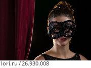 Купить «Woman wearing masquerade mask», фото № 26930008, снято 20 апреля 2017 г. (c) Wavebreak Media / Фотобанк Лори