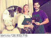 Купить «Woman makeup artist and man hairdresser in the salon», фото № 26933716, снято 23 сентября 2018 г. (c) Яков Филимонов / Фотобанк Лори