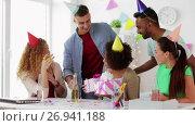 Купить «team greeting colleague at office birthday party», видеоролик № 26941188, снято 6 сентября 2017 г. (c) Syda Productions / Фотобанк Лори