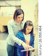Купить «Mother and daughter enjoying expositions of previous centuries», фото № 26950464, снято 12 декабря 2017 г. (c) Яков Филимонов / Фотобанк Лори