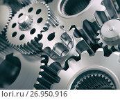 Купить «Gears and cogwheels engine industrial background.», фото № 26950916, снято 18 января 2019 г. (c) Maksym Yemelyanov / Фотобанк Лори