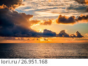 Dramatic sky during a hurricane and sunset over the ocean. Стоковое фото, фотограф Mikhail Starodubov / Фотобанк Лори