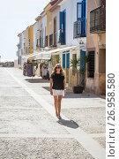 Купить «Solo femail tourist walks down the main street of the Spanish island of Tabarca.», фото № 26958580, снято 20 июня 2017 г. (c) age Fotostock / Фотобанк Лори
