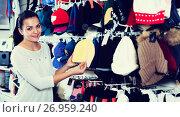 Купить «Woman choosing new knit cap», фото № 26959240, снято 22 ноября 2016 г. (c) Яков Филимонов / Фотобанк Лори