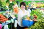 Adult female taking vegetables with basket, фото № 26959292, снято 10 марта 2017 г. (c) Яков Филимонов / Фотобанк Лори