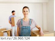 Купить «happy couple with boxes moving to new home», фото № 26960124, снято 4 июня 2017 г. (c) Syda Productions / Фотобанк Лори