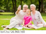Купить «senior grandparents and granddaughter selfie», фото № 26960160, снято 9 августа 2017 г. (c) Syda Productions / Фотобанк Лори