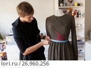 Купить «fashion designer with dummy making dress at studio», фото № 26960256, снято 28 июня 2017 г. (c) Syda Productions / Фотобанк Лори