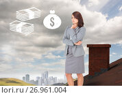 Купить «Money icons and Businesswoman standing on Roof with chimney in country with city in distance», фото № 26961004, снято 15 октября 2018 г. (c) Wavebreak Media / Фотобанк Лори