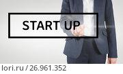 Купить «Hand interacting with start-up business text against white background», фото № 26961352, снято 23 февраля 2020 г. (c) Wavebreak Media / Фотобанк Лори