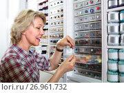 Купить «mature woman in sewing store», фото № 26961732, снято 23 мая 2019 г. (c) Яков Филимонов / Фотобанк Лори
