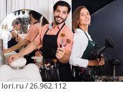 Купить «Smiling woman hairdresser and male makeup artist», фото № 26962112, снято 23 сентября 2018 г. (c) Яков Филимонов / Фотобанк Лори