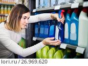 Купить «Girl customer looking for effective deodorant in supermarket», фото № 26969620, снято 23 ноября 2016 г. (c) Яков Филимонов / Фотобанк Лори