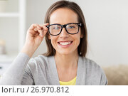 Купить «happy smiling middle aged woman in glasses at home», фото № 26970812, снято 22 апреля 2017 г. (c) Syda Productions / Фотобанк Лори
