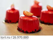 Купить «strawberry mirror glaze cakes at confectionery», фото № 26970880, снято 8 мая 2017 г. (c) Syda Productions / Фотобанк Лори