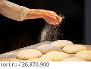 Купить «chef or baker making bread dough at bakery», фото № 26970900, снято 15 мая 2017 г. (c) Syda Productions / Фотобанк Лори